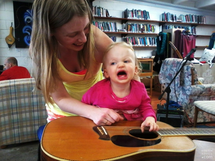Baby rocking out on guitar